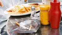 Fast food and a cigarette (Getty)