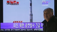 A South Korean man walks past a television with coverage of the North Korean missile launch (Reuters)
