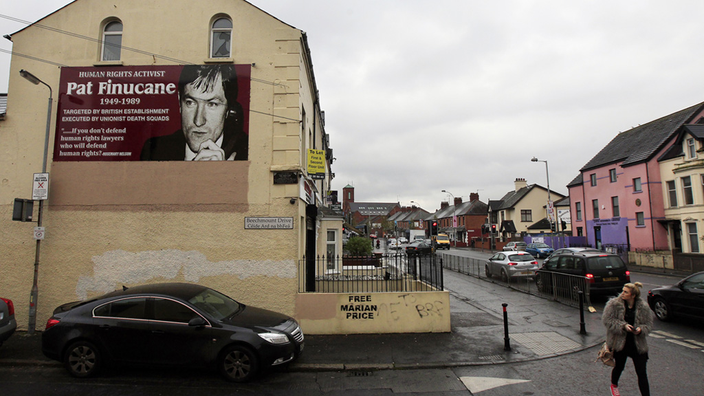 A poster of Pat Finucane on the side of a building in west Belfast. (Reuters)