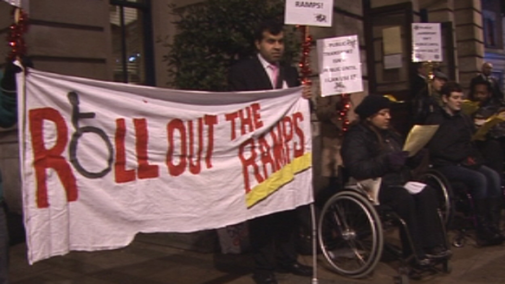 Protesters sang carols in Stratford to call for better tube access.