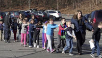 School shooting: children led away (Newtown Bee via APTN)