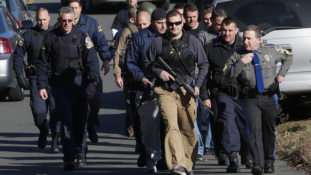 Connecticut shootings: armed police on patrol (Reuters)