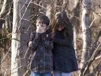 Two young children wait outside Sandy Hook Elementary School after a shooting in Newtown. (Reuters)