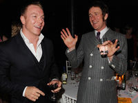 Suits you sir. Bradley Wiggins compares suits with the other cycling superman, Sir Chris Hoy.