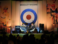 Pin-striped Bradley in purple socks and tie in front of a giant Mod target sign - the sacred emblem of Mod culture.