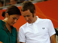 A timeless classic - Bradley Wiggins sports the famous Laurel logo of Fred Perry on a simple white polo shirt. Crisp.