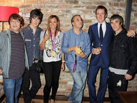 From one Manc icon to some more - Bradley meets the Stone Roses to celebrate their comeback and his summer of success.