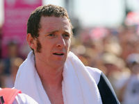 Got any talc? Bradley draped in a towel after his time trial cycling victory at the London Olympics.