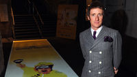 Bradley Wiggins in a double-breasted suit showing of his 60s stylings. (Getty)