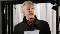 Julian Assange marks six months in his gilded Knightsbridge cage with a Christmas address from the balcony of London's Ecuadorian embassy.