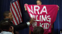 NRA press conference: gun control activist ejected - video