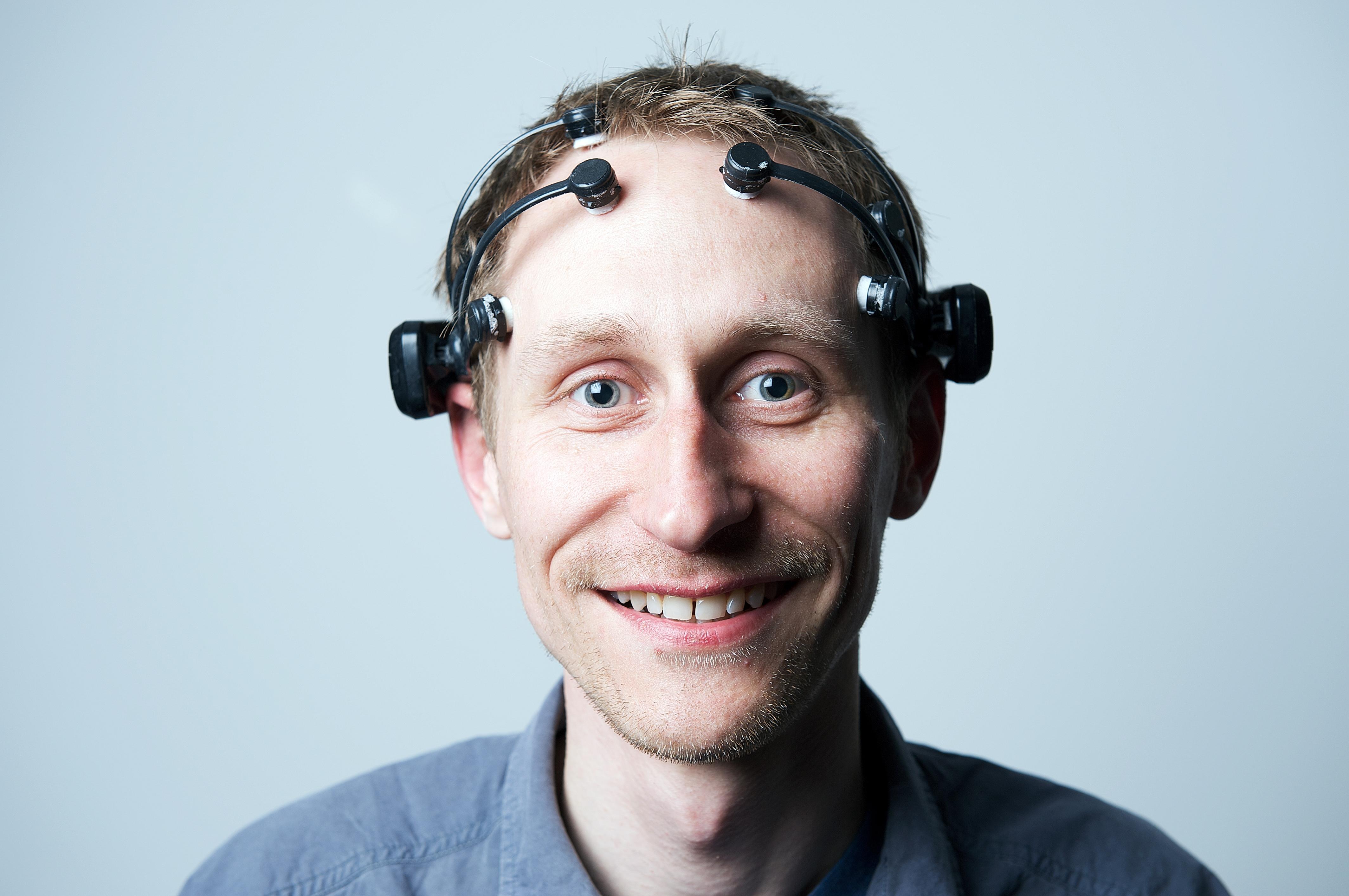 IBM's Kevin Brown wearing the Emotiv headset