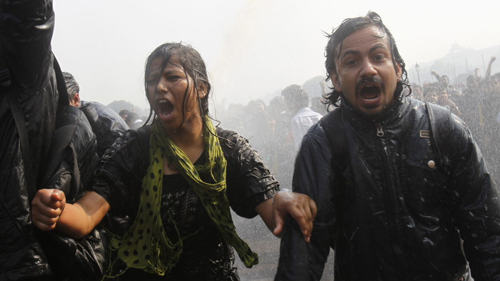 Two of the protestors at the presidential residences in New Delhi, India (Reuters)