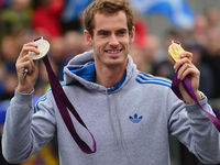 US Open winner and Olympic gold medalist Andy Murray capped off his best year in sport with an OBE for services to tennis.News