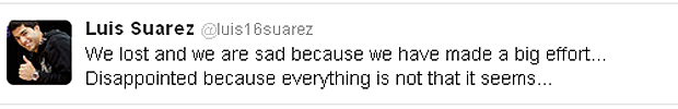 Luis Suarez, who appeared to snub the outstretched hand of Evra, said on Twitter 'everything is not that it seems'