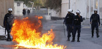 Bahraini security forces fire tear gas and stun grenades as protesters gather to mark the anniversary of an uprising that was crushed by military force (Reuters)