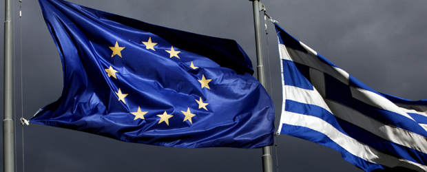 A European Union (EU) flag, left, and Greek national flag fly near the Parthenon temple on Acropolis hill in Athens, Greece (Getty)
