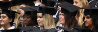 Students at the University of Birmingham pose for a group photograph as they take part in their degree congregations on July 14, 2009 (Getty)