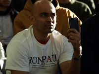 A man listens to Ron Paul speak. Paul's events were dominated by young voters. (Tawanda Kanhema)
