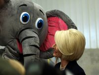 Newt Gingrich's wife, Callista Gingrich, looks at a mascot from her new children's book at a campaign event. (Tawanda Kanhema)