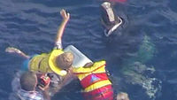 Party of four rescued off Sydney using cool box to stay afloat