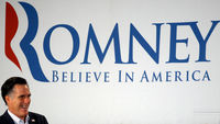 Mitt Romney in front of campaign banner (Reuters)