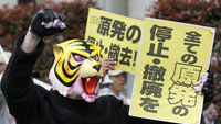 Animals, too, seem to be popular with today's discerning protester. Anti nuclear demonstrators use the tiger to make their point in Tokyo.