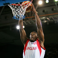 Michael Martin of England dunks in the men's bronze medal basketball game between England and Nigeria in 2006 (Getty)