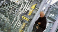 James Dyson, creator of the Dyson vacuum cleaner, with his invention. (Getty)