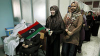 Libyans vote in the first free national elections in 60 years, some joyful and others storming police stations and burning ballot boxes and voting slips.