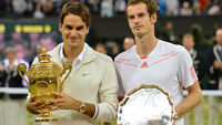 Roger Federer (L) poses with the trophy with loser Britain's Andy Murray (R) after his men's singles final victory (Getty)