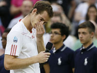 2012: The previously stony Andy Murray won the hearts of the crowd after a gruelling Wimbledon final against Roger Federer.