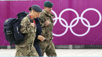 Soldiers outside an Olympics venue having been drafted in to boost security (Reuters)