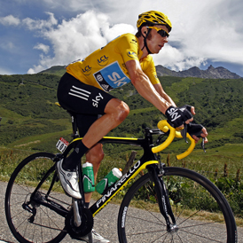 Bradley Wiggins riding in the tour de france wearing the leader's yellow jerse (Reuters)