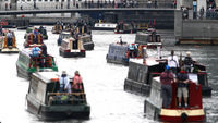 Barges arrive at South Quay, where many of the boats taking part in the Queen's Diamond Jubilee River Pageant are moored (Getty)