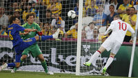Wayne Rooney takes a shot on goal at the Euro 2012 championship match against Ukraine (reuters)