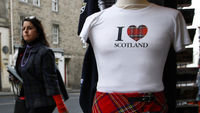 A woman walks past a shopwindow displaying an I Love Scotland t-shirt (Reuters)