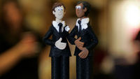 Gay figurines on wedding cake (reuters)