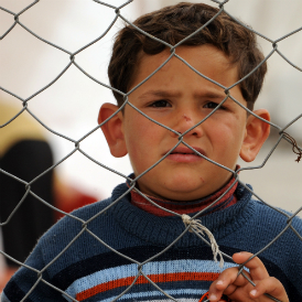 A young Syrian boy in a refugee camp. (Getty)