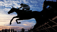 Silhouette of Horses Jumping a Steeplchase (Getty)