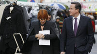 Britain's Prime Minister David Cameron and retail expert Mary Portas walk through a street market in Camden, London (Getty)