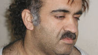 Khalid Sheikh Mohammed and four others who say they planned the 9/11 attacks on New York and Washington appear in a military court charged with murdering 2,976 people.