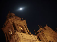 The moon looms above the cathedral towers in Guatemala City, 5 May 2012.