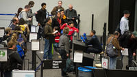US air passengers go through security in San Francisco