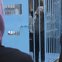 A man stands in mock prison cell in Ramallah during a rally in support of Palestinian prisoners on hunger strike