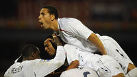 Rio Ferdinand celebrate's a goal with England players