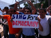 Protestors from the campaign group Sing for Democracy in a flash protest in central Baku on Monday afternoon.