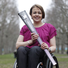 Paralympian Tanni Grey-Thompson forced to 'crawl' off train. (Reuters)