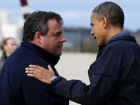 President Obama is greeted by New Jersey Governor Christie in New Jersey (Reuters).