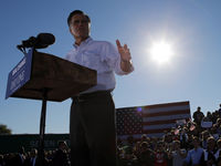 Republican presidential nominee Mitt Romney pauses while speaking at a campaign rally in Davenport (Reuters).